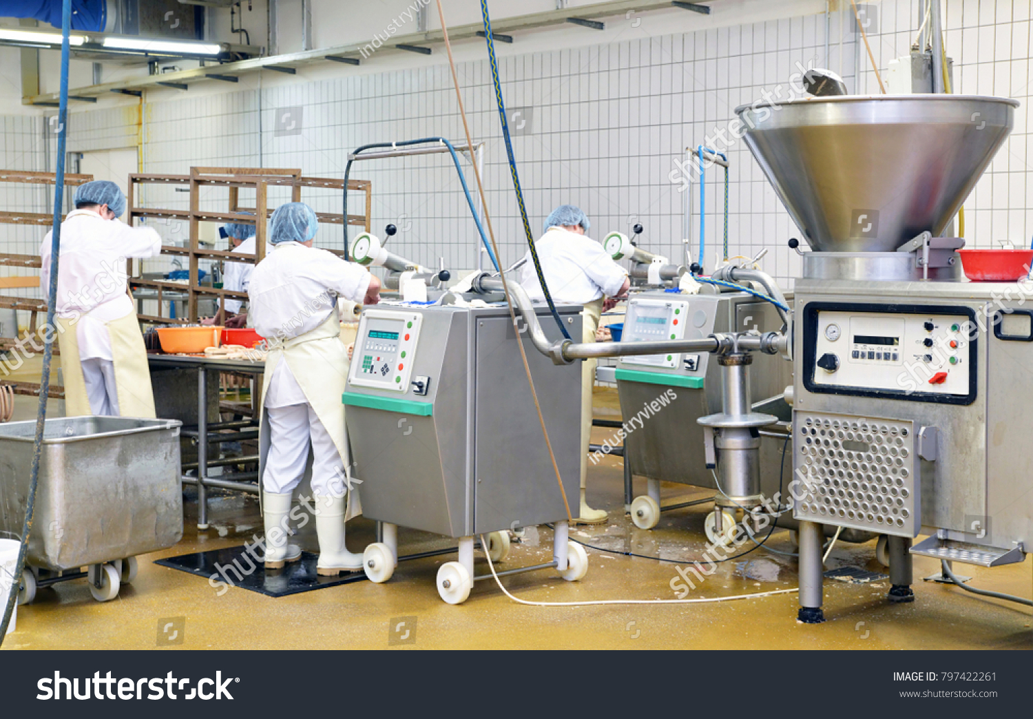 stock-photo-workers-in-the-production-of-original-german-bratwurst-in-a-large-meat-processing-plant-in-the-food-797422261